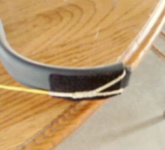 Notched end of PVC bow with felt to quieten string slap