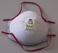 Protective air-purifying respirator with valve