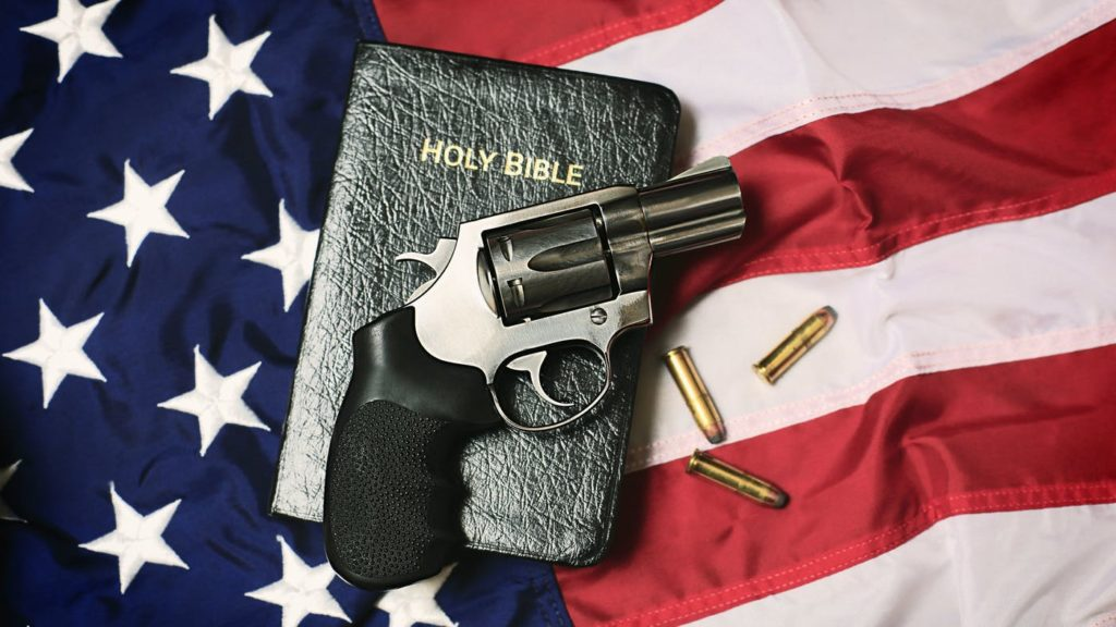 Bible, flag, pistol and bullets