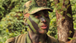 Soldier with camouflaged face paint
